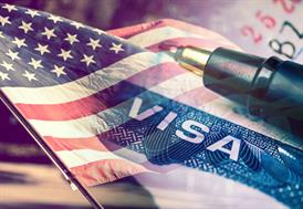 American flag, Visa and pen - Employment Immigration